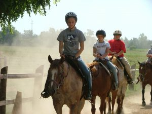 Kids on dusty trail ride